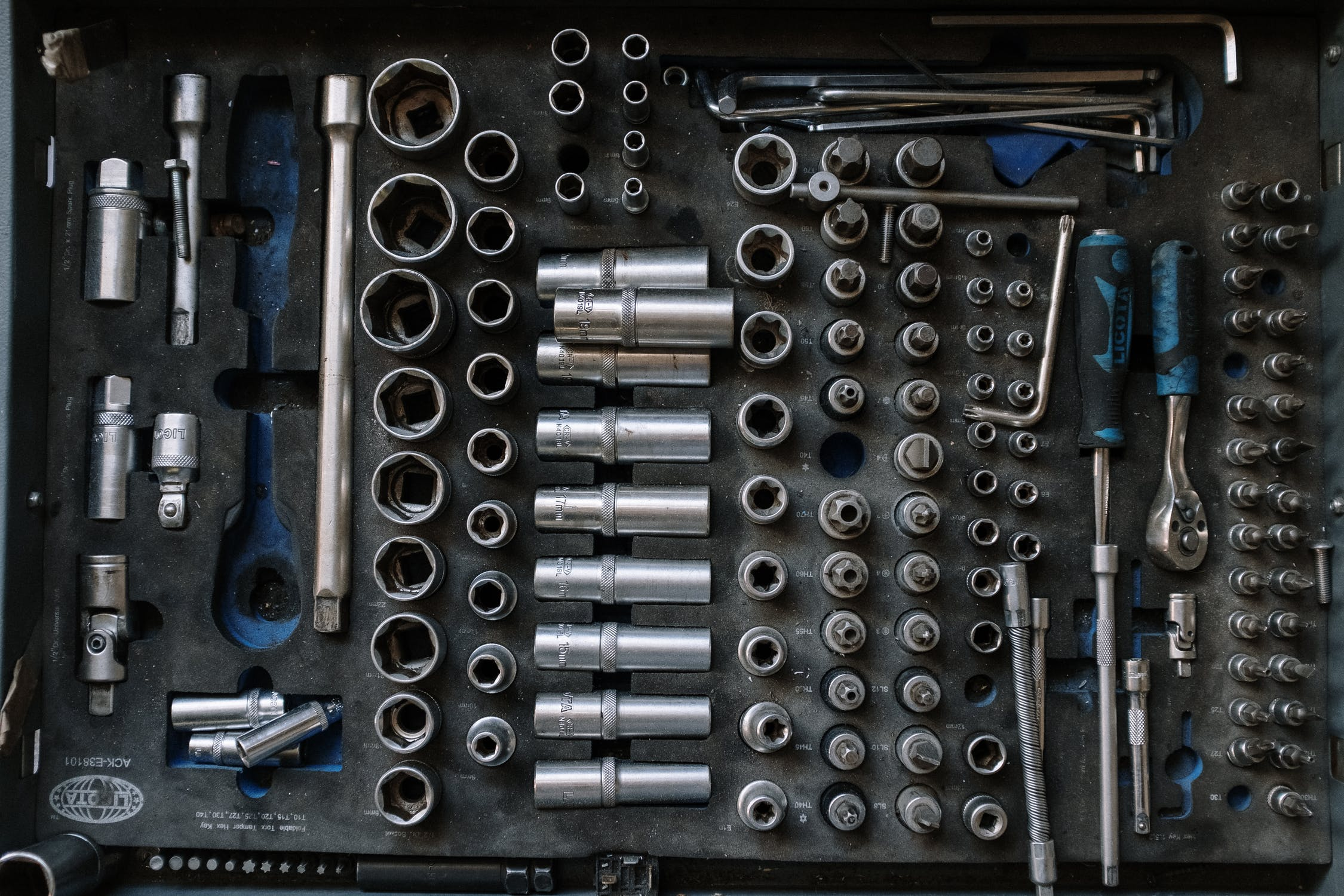 A selection of silver tools in a tool kit.