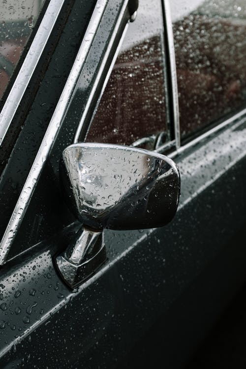 Black Car Side Mirror With Water Droplets