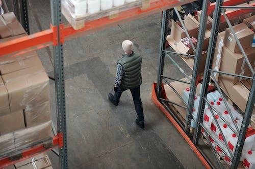 Man Walking on a Warehouse
