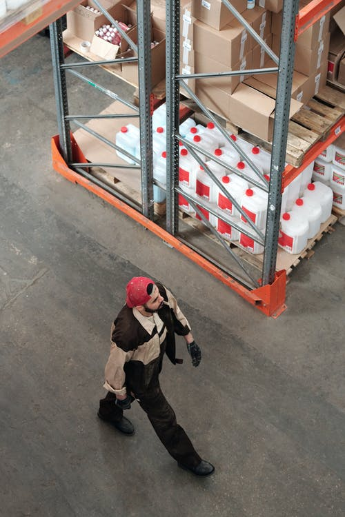 Man Walking in a Warehouse