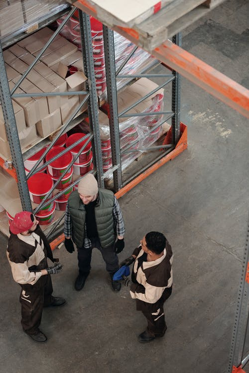 Men Standing in a Warehouse Talking