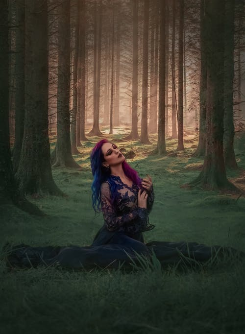 Tranquil woman in dramatic woods in summer