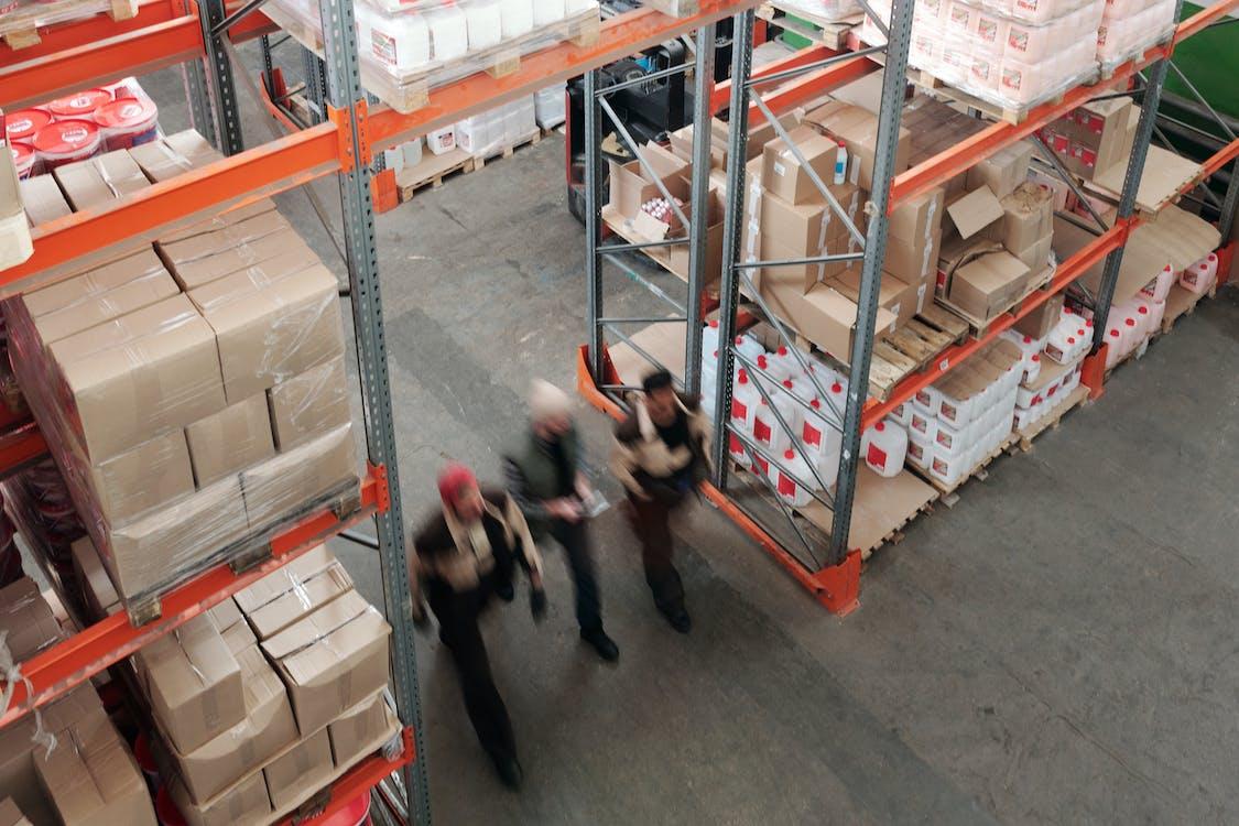 Men Walking in a Warehouse