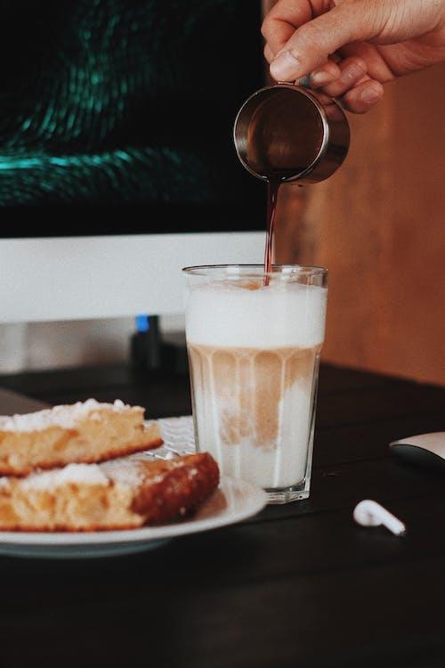 Close-Up Photo of a Brown Liquid Sugar Poured into a Glass