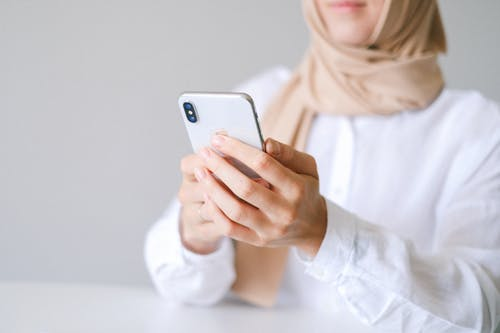 Photo of Person using White Smartphone