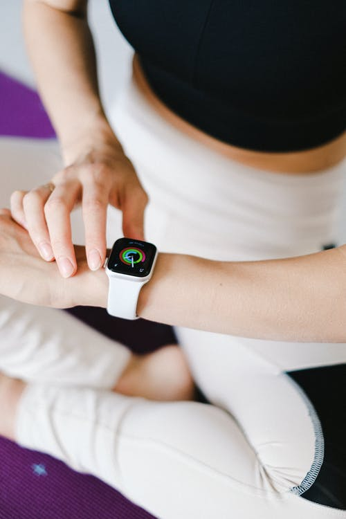 Person Wearing White Apple Watch