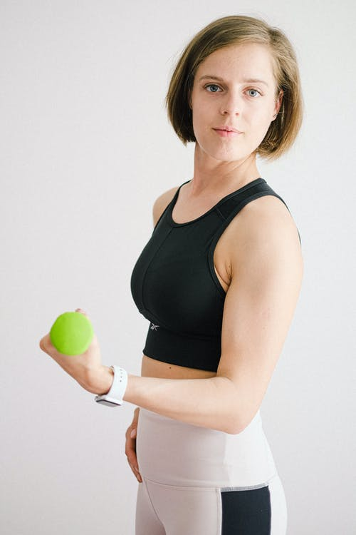Woman in Black Tank Top Holding Green Apple