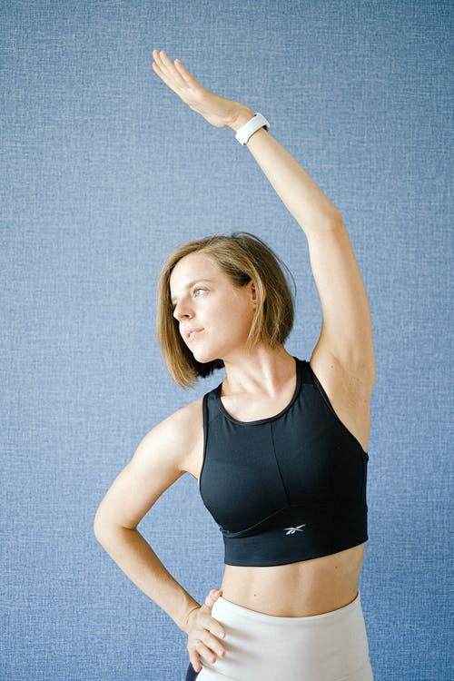 Woman in Black Sports Bra Exercising
