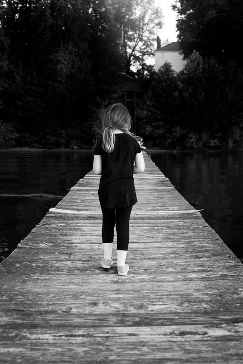 Girl Walking in Wooden Dock