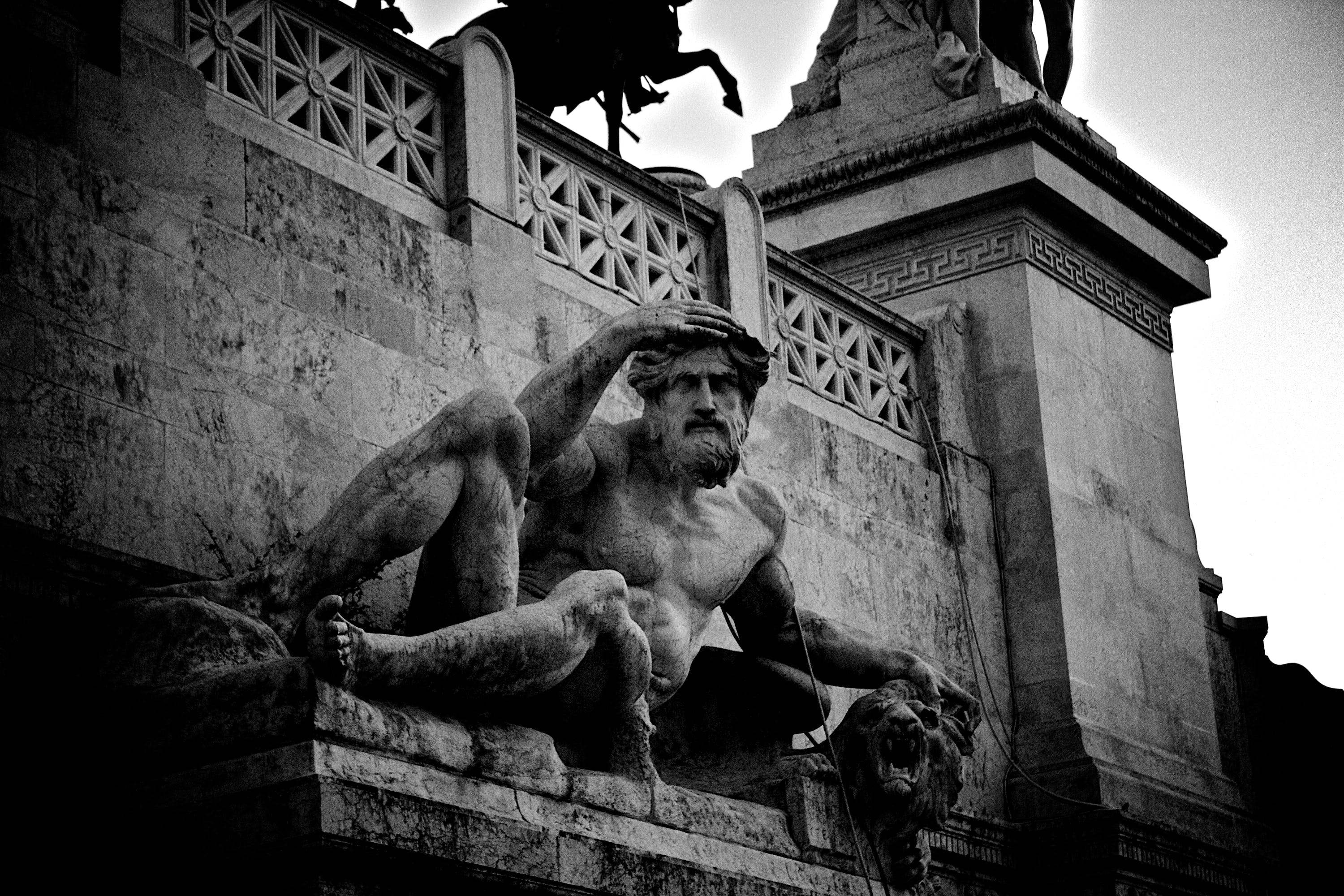 Grayscale Photography of Man Statue