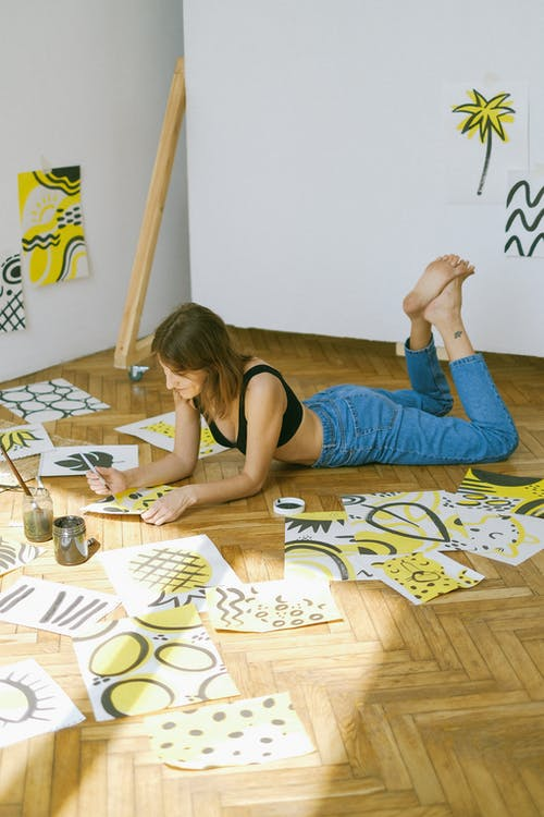 Woman Lying on Floor While Painting