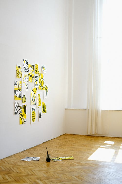 Photo of Paintings on White Wall