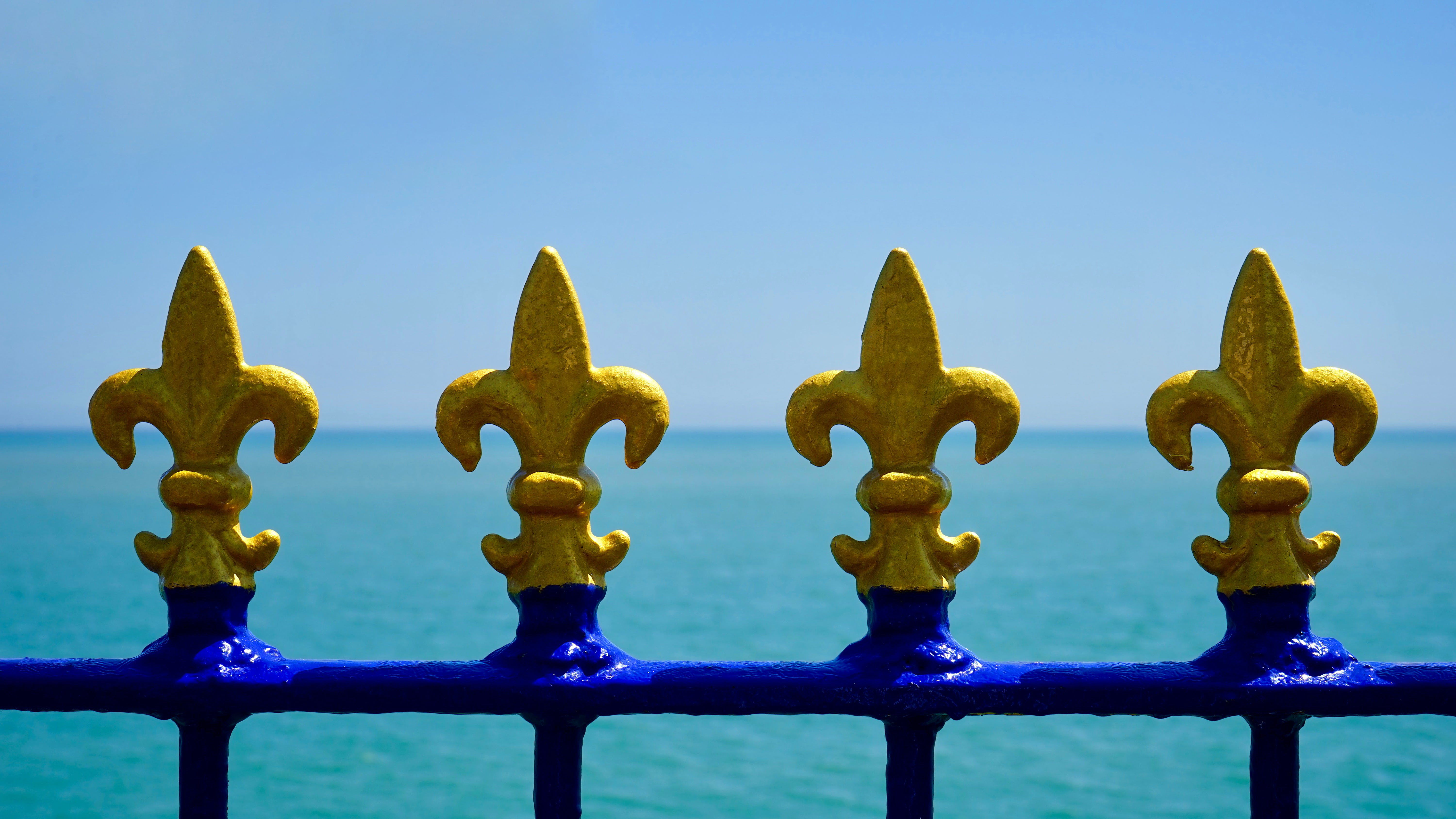 Closeup Photo of Four Yellow Finials