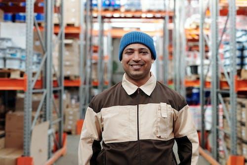Photo of Man Wearing Blue Beanie Smiling