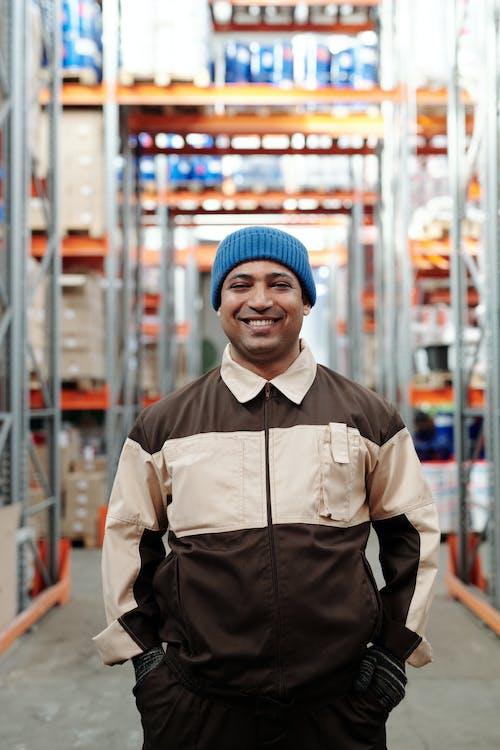 Photo of Man Wearing Blue Bonnet Smiling