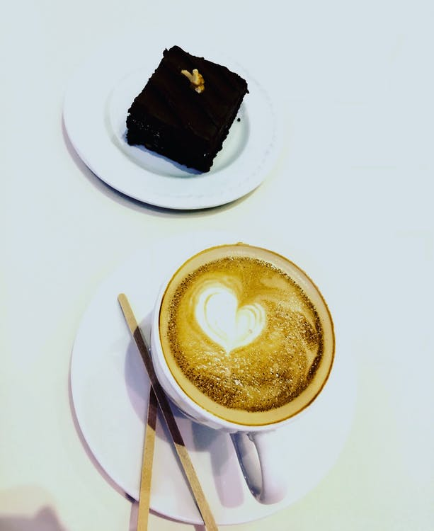 Slice of Brownies and Coffee Latte