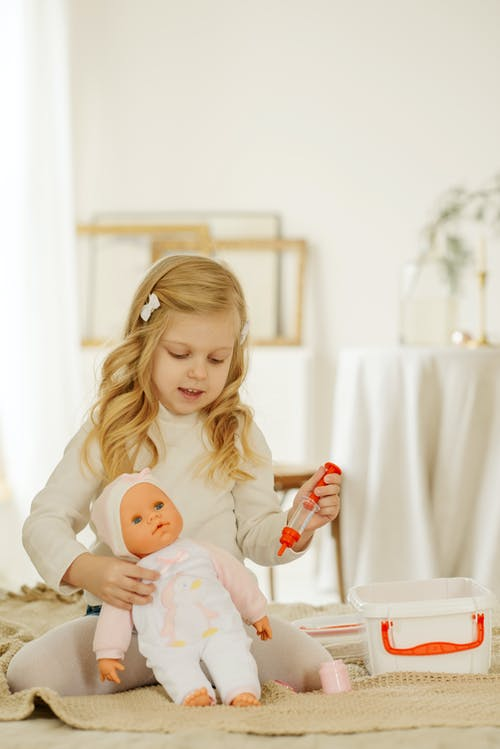 Girl Playing With Baby Doll