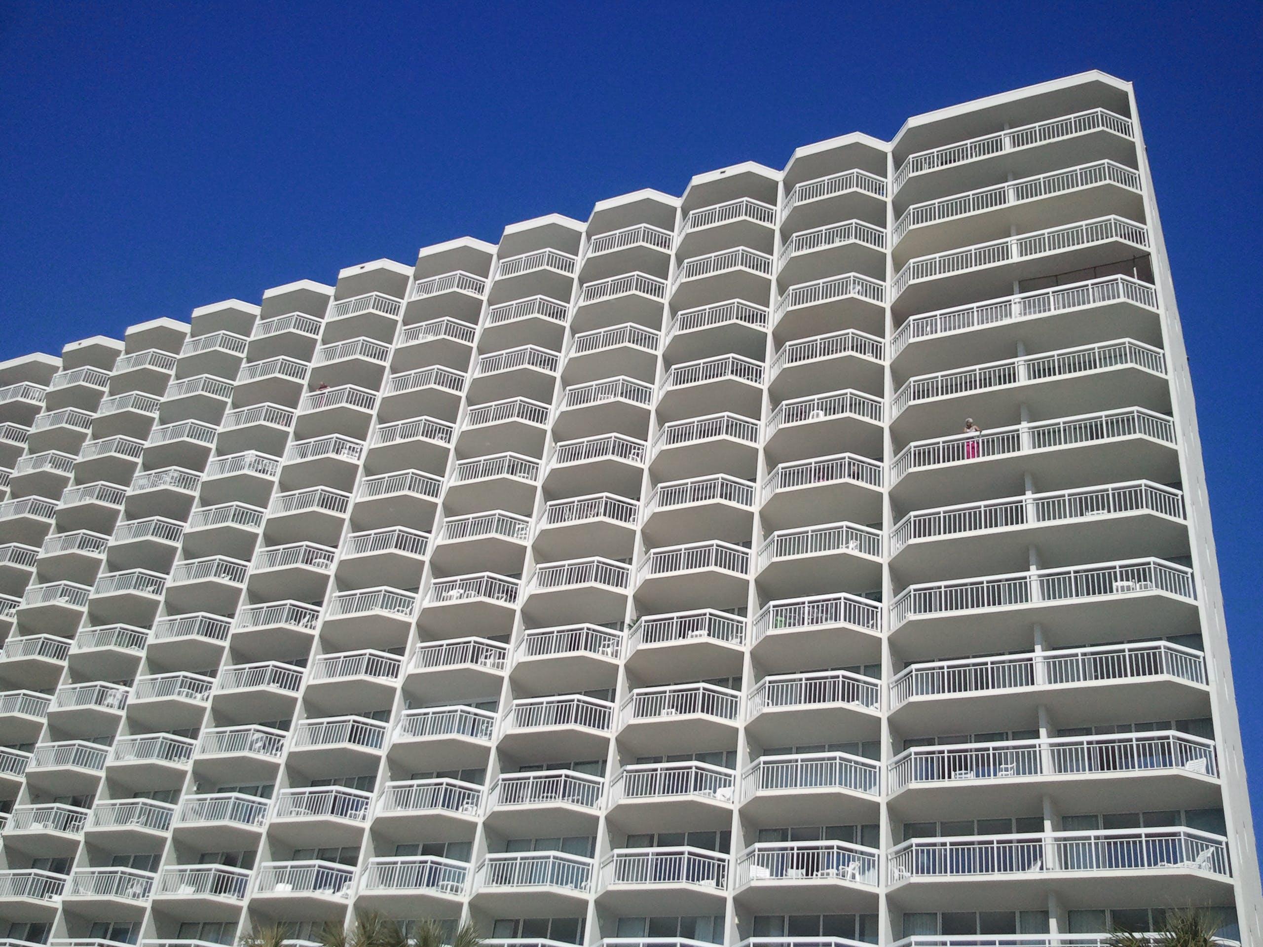 White Condominium Building Under Blue Sky