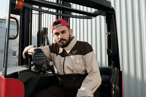 Close Up Photo of Forklift Operator