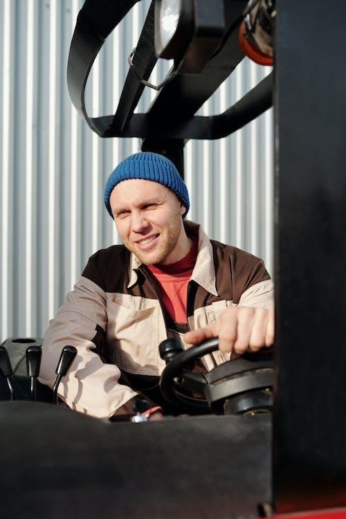 Operator Holding the Steering Wheel