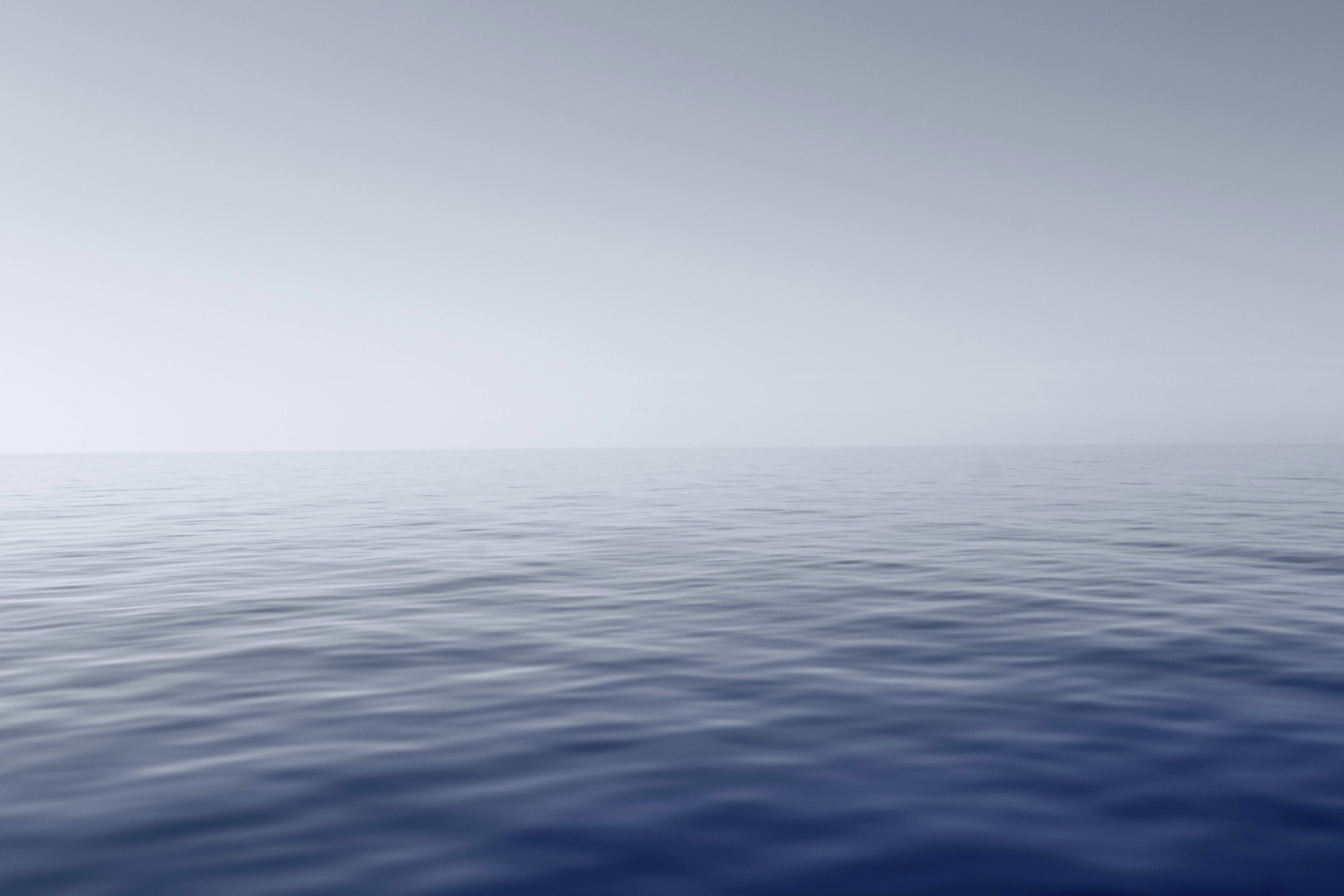 Blue Body of Water With Fog