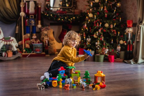 Boy Playing With Toys on Floor