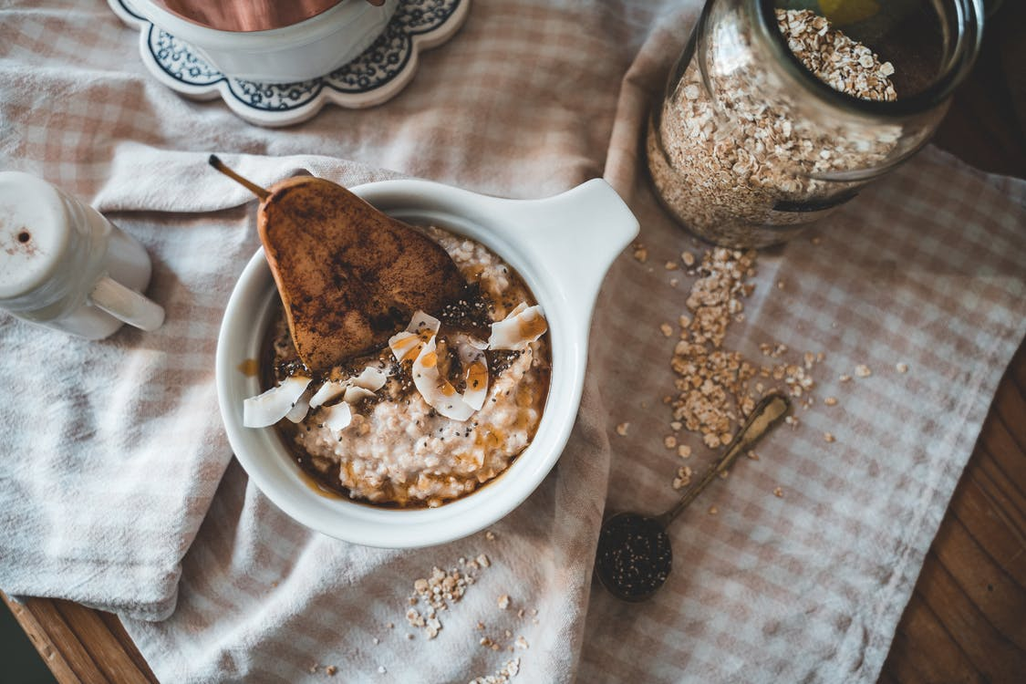 White Ceramic Bowl With Rice and Brown Bread