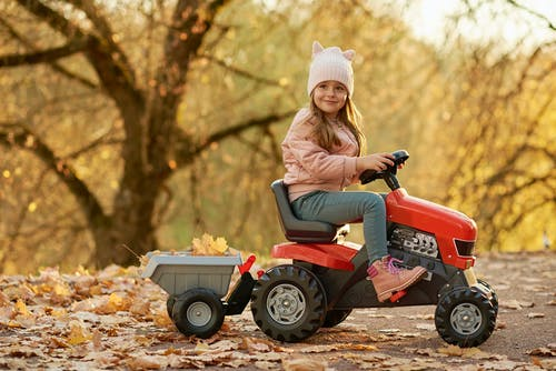 Beautiful Girl on a Tractor Toy