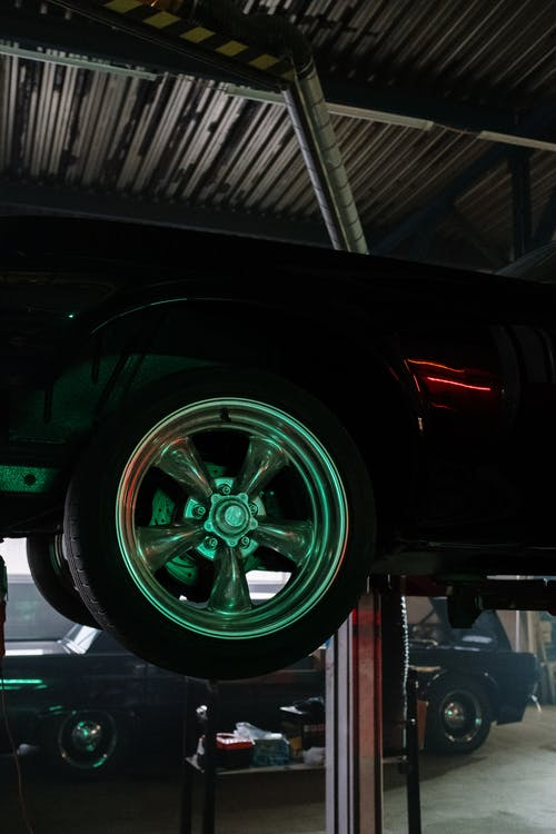 Black Car With Green Wheel