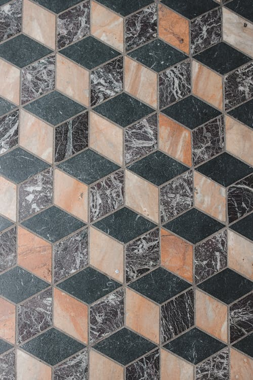 Geometric mosaic ornament on tiled floor
