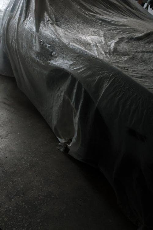 White Textile on Gray Concrete Floor