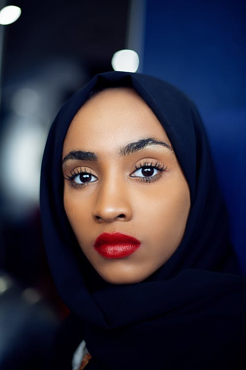 Woman in Black Hijab and Red Lipstick