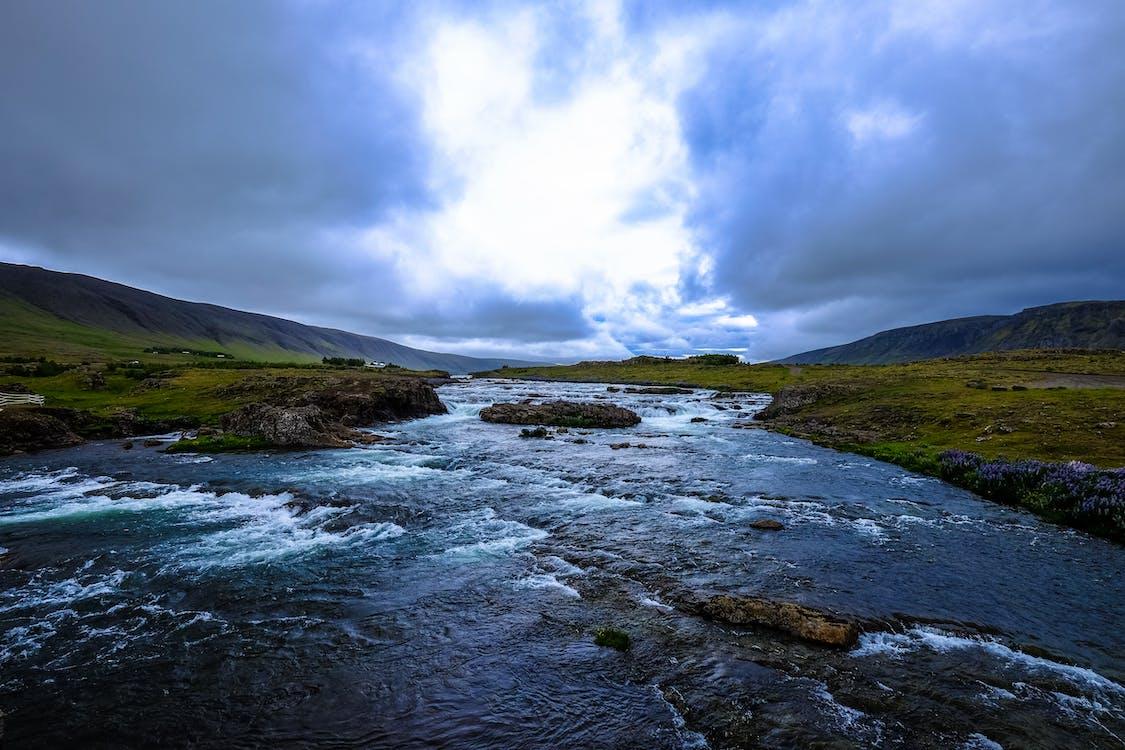 Water Stream Under Grey Clouds