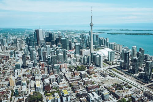 Drone view of modern metropolis city of Toronto with high rise towers and landmark CN Tower located on vast seacoast