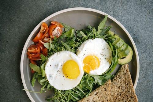 Sliced Tomato and Green Vegetable Salad on White Ceramic Plate