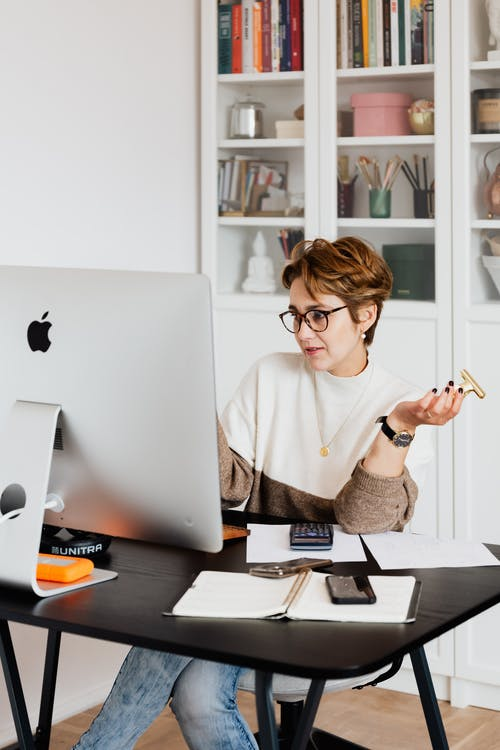 Focused businesswoman working with computer in office