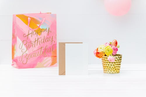 Happy Birthday Greeting Card on White Table