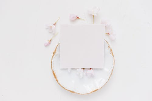 White Paper on White and Yellow Floral Round Plate