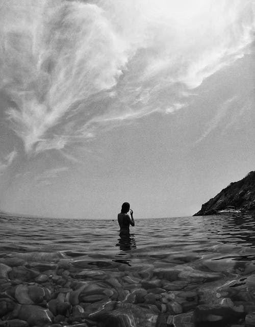 Anonymous woman recreating in sea during summer holidays