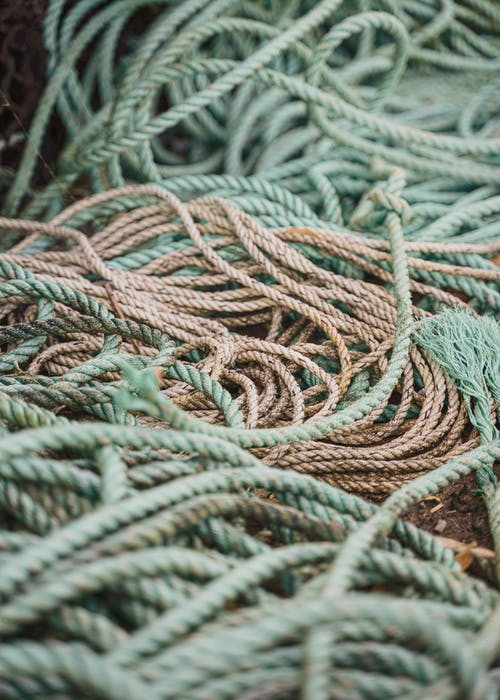 Tangled wicker mooring ropes in ship