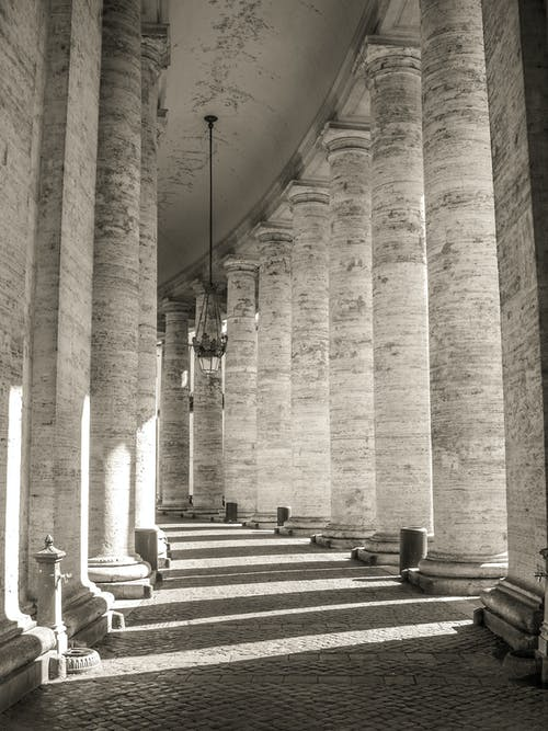 Columned passage of ancient building on sunny day