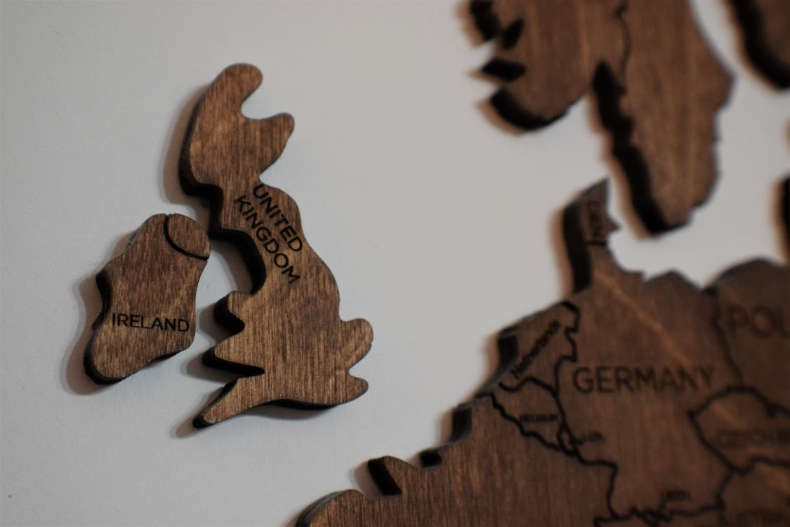 Brown Wooden Jigsaw Puzzle Piece