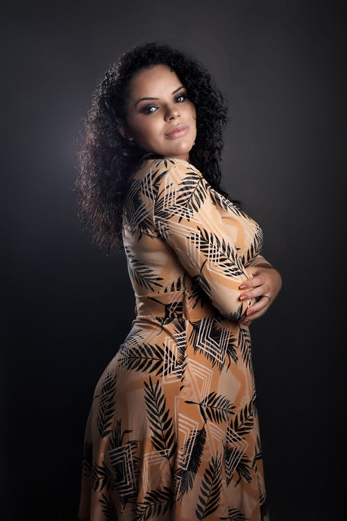 Elegant young ethnic lady with crossed arms