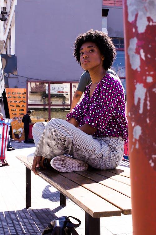 Black woman resting on bench