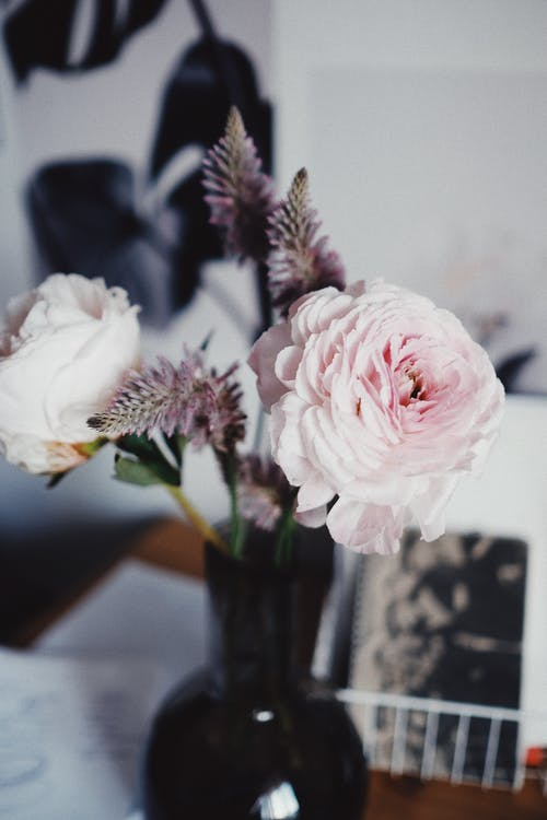 Bouquet of roses in vase on table