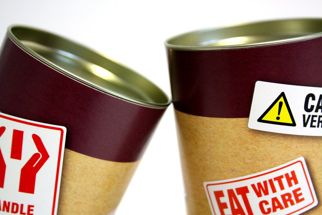 Two Cans With Signages