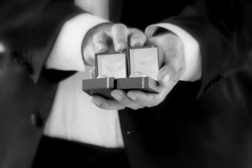 Person Holding Ring Boxes