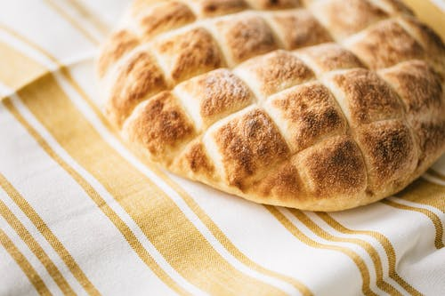 Fresh baked bread on striped tablecloth