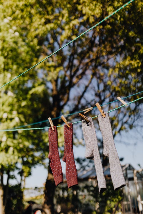 Clean cotton socks drying on clothesline