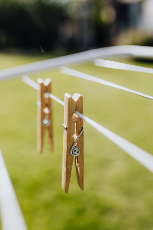 Set of wooden clothespins on clotheshorse in yard